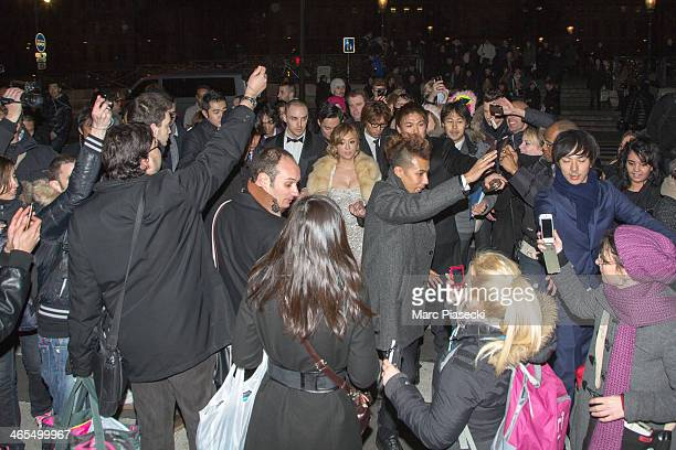 Singer Ayumi Hamasaki and her boyfriend are surrounded by fans as they leave the 'Buddha 2' Paris Premiere at the 'Pont des Arts' Bridge on January...