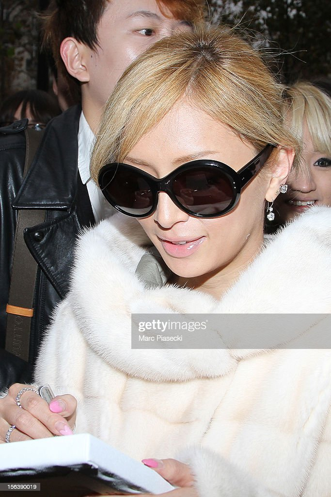 Singer <a gi-track='captionPersonalityLinkClicked' href=/galleries/search?phrase=Ayumi+Hamasaki&family=editorial&specificpeople=2371548 ng-click='$event.stopPropagation()'>Ayumi Hamasaki</a> signs autographs as she is seen at her hotel on November 14, 2012 in Paris, France.
