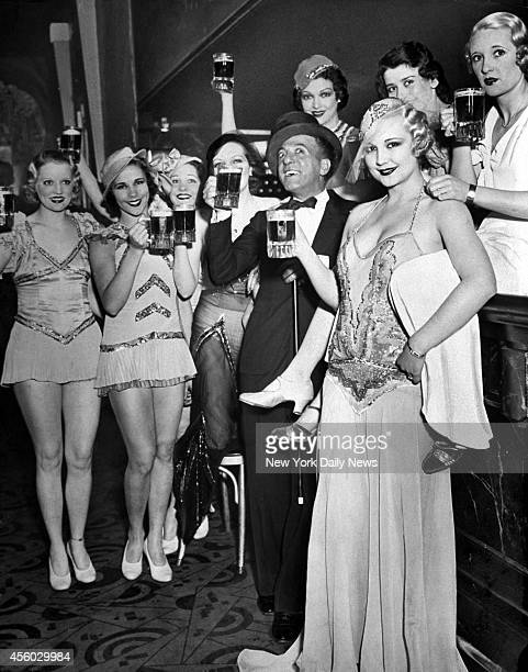 Singer Bandleader Ted Lewis is surrounded by 'Broadway Beauties' as they toast the repeal of Prohibition at the Hollywood Club