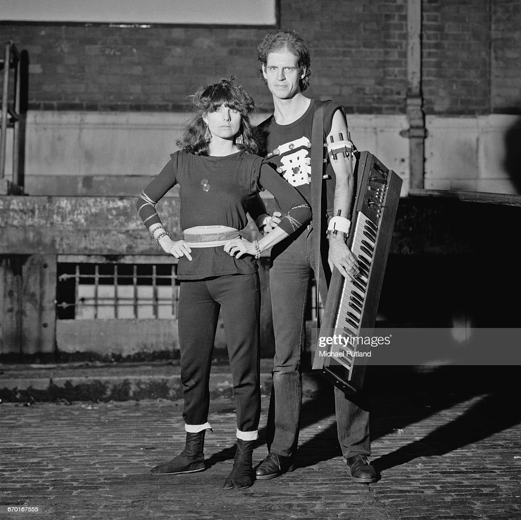 Singer Barbara Gaskin and keyboard player Dave Stewart, London, 1982. Stewart is holding a Korg synthesizer and wearing several torches strapped to his arm.