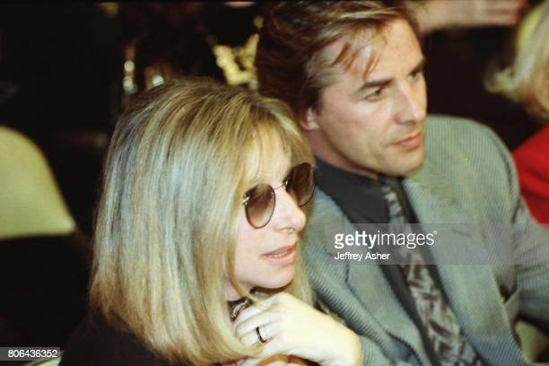 Singer Barbra Streisand and Actor Don Johnson ringside at Tyson vs Holmes Convention Hall in Atlantic City New Jersey January 22 1988