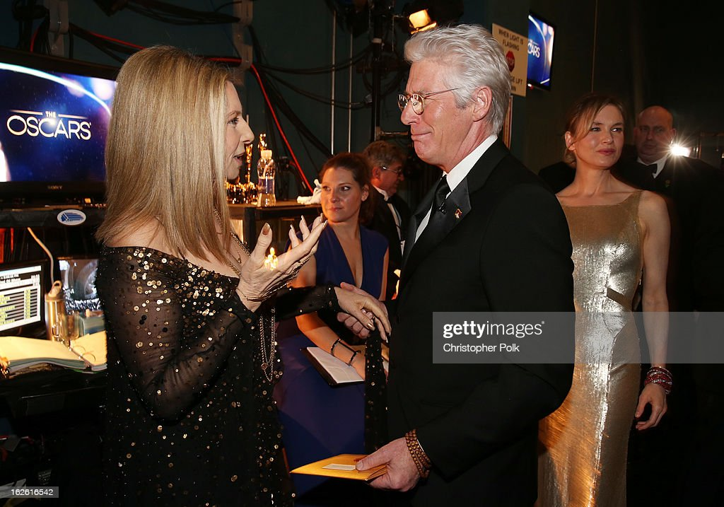 Singer Barbra Streisand (L) and actor Richard Gere backstage during the Oscars held at the Dolby Theatre on February 24, 2013 in Hollywood, California.