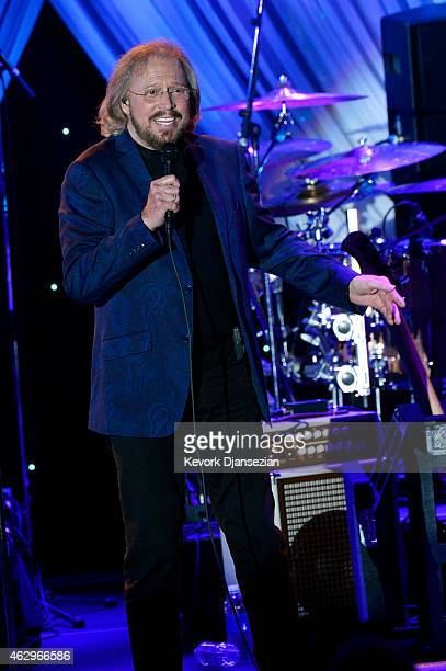 Singer Barry Gibb of The Bee Gees performs onstage during the PreGRAMMY Gala and Salute To Industry Icons honoring Martin Bandier at The Beverly...