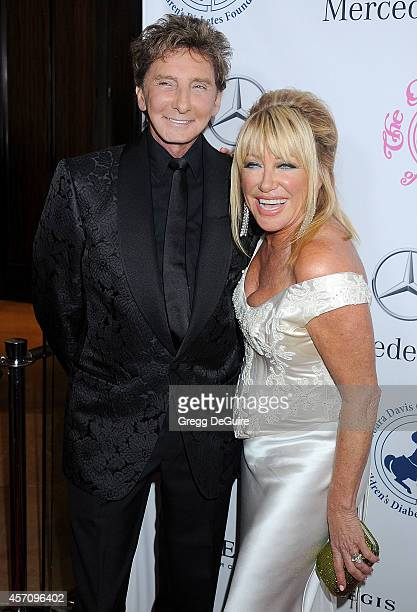 Singer Barry Manilow and actress Suzanne Somers arrive at the 2014 Carousel Of Hope Ball Presented By MercedesBenz at The Beverly Hilton Hotel on...