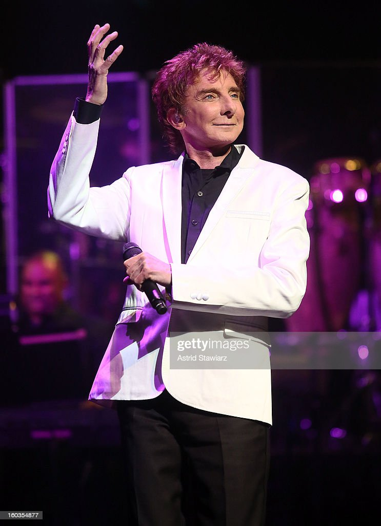 Singer <a gi-track='captionPersonalityLinkClicked' href=/galleries/search?phrase=Barry+Manilow&family=editorial&specificpeople=210534 ng-click='$event.stopPropagation()'>Barry Manilow</a> peforms during the curtain call of Manilow On Broadway Opening Night at the St. James Theatre on January 29, 2013 in New York City.