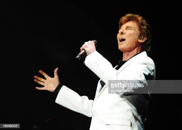 Singer Barry Manilow performs during curtain call for Manilow On Broadway Opening Night at the St James Theatre on January 29 2013 in New York City