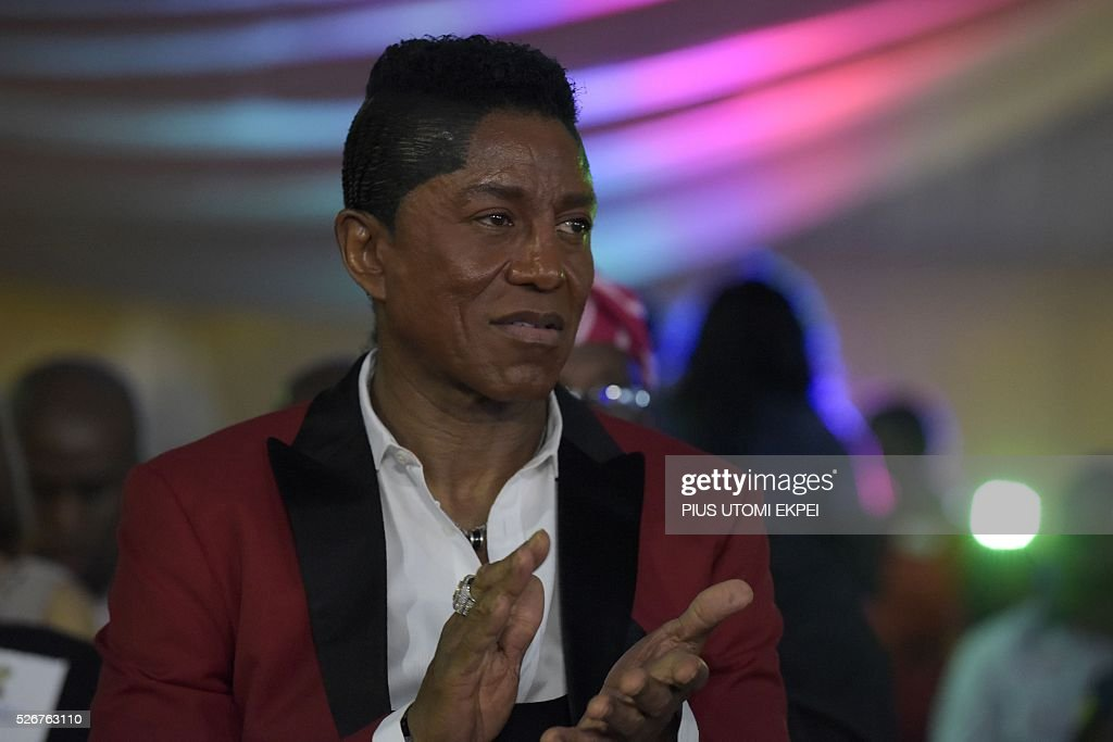 US singer, bass guitarist and composer Jermaine Jackson applauds as he attends International Jazz Day in Lagos on April 30, 2016. Jazz enthusiasts gathered at the government house in Lagos, Nigeria's commercial capital to mark the International Jazz Day, a global event designed to highlight jazz, its roots, future, impact and its diplomatic role of uniting people across the world. / AFP / PIUS