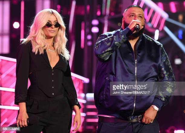 Singer Bebe Rexha and DJ Khaled speak onstage during the 2017 Billboard Music Awards at TMobile Arena on May 21 2017 in Las Vegas Nevada