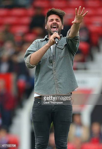 Singer Ben Haenow performs during the Manchester United Foundation charity match between Manchester United Legends and Bayern Munich All Stars at Old...