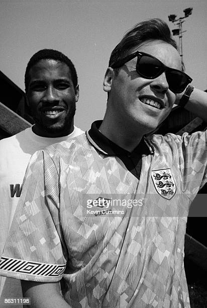Singer Bernard Sumner of English rock group New Order with footballer John Barnes after they recorded the official song of the England national...