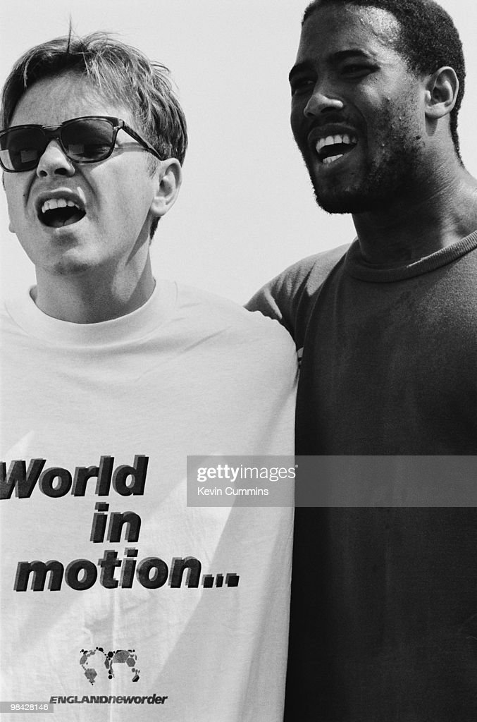 Singer Bernard Sumner of English rock group New Order with footballer John Barnes whilst filming the video for the official song of the England football team's 1990 World Cup campaign, 'World in Motion', 5th May 1990.