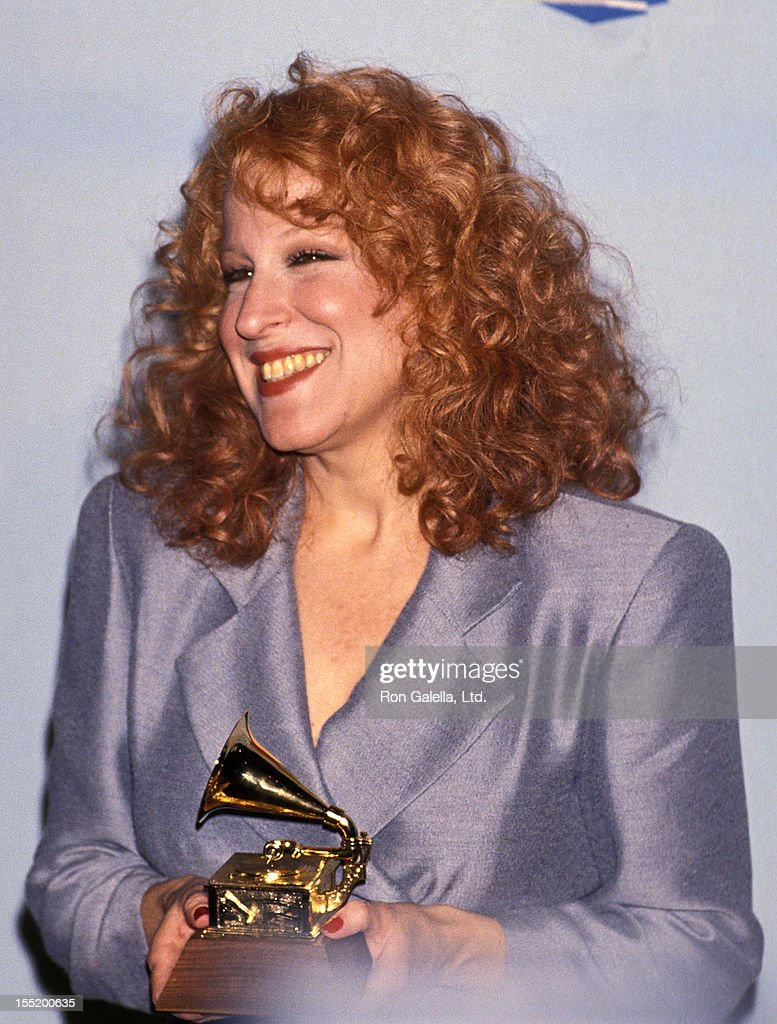 Singer <a gi-track='captionPersonalityLinkClicked' href=/galleries/search?phrase=Bette+Midler&family=editorial&specificpeople=201551 ng-click='$event.stopPropagation()'>Bette Midler</a> attends the 32nd Annual Grammy Awards on February 21, 1990 at Shrine Auditorium in Los Angeles, California.