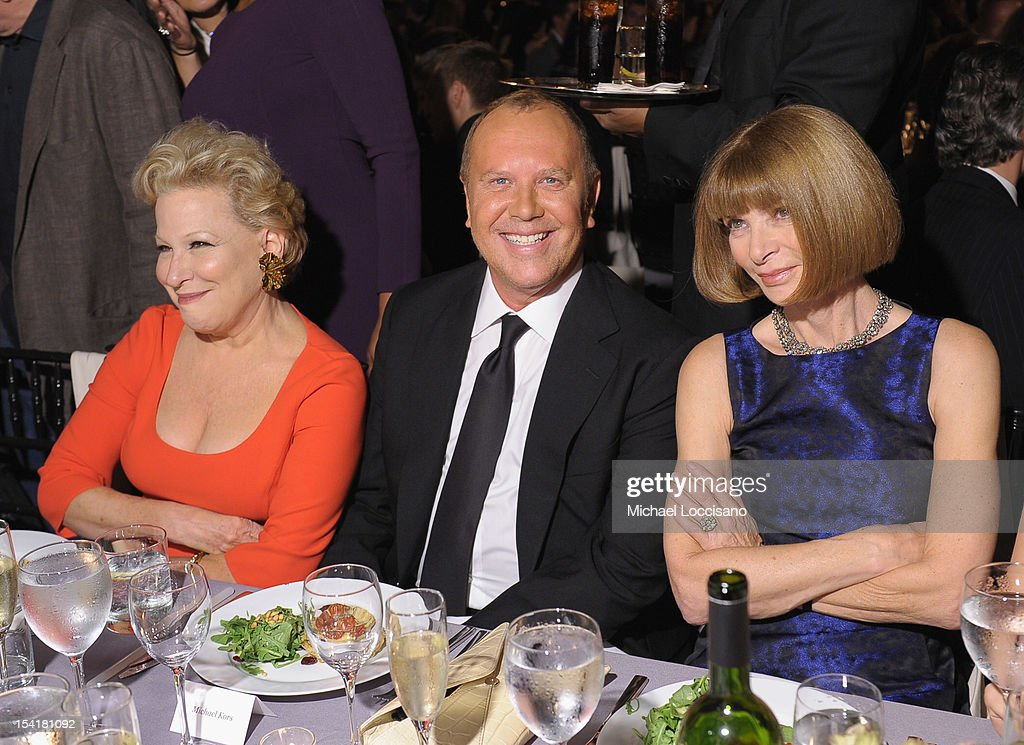 Singer <a gi-track='captionPersonalityLinkClicked' href=/galleries/search?phrase=Bette+Midler&family=editorial&specificpeople=201551 ng-click='$event.stopPropagation()'>Bette Midler</a>, designer Michael Kors and editor-in-chief of American Vogue <a gi-track='captionPersonalityLinkClicked' href=/galleries/search?phrase=Anna+Wintour&family=editorial&specificpeople=202210 ng-click='$event.stopPropagation()'>Anna Wintour</a> pose at the Michael Kors- Golden Heart Gala at Cunard Building on October 15, 2012 in New York City.