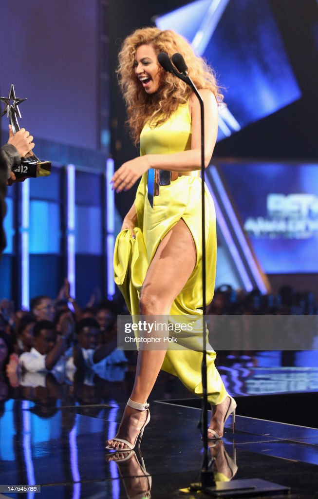 Singer Beyonce accepts the award for Best Female R&B Artist onstage during the 2012 BET Awards at The Shrine Auditorium on July 1, 2012 in Los Angeles, California.