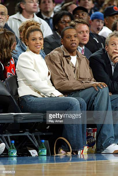 Singer Beyonce and rapper JayZ and Infinity Broadcasting CEO John Sykes sit courtside at the New York Knicks v Cleveland Cavaliers game at Madison...