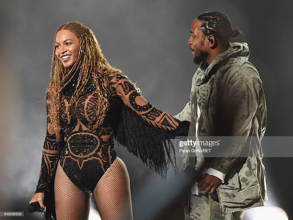 Singer Beyonce (L) and rapper <a gi-track='captionPersonalityLinkClicked' href=/galleries/search?phrase=Kendrick+Lamar&family=editorial&specificpeople=8012417 ng-click='$event.stopPropagation()'>Kendrick Lamar</a> perform onstage during the 2016 BET Awards at the Microsoft Theater on June 26, 2016 in Los Angeles, California.