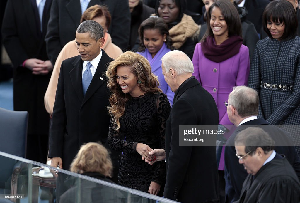 Singer Beyonce, center, shakes hands with U.S. Vice President Joe Biden, right, while standing next to President Barack Obama, left, during the U.S. presidential inauguration in Washington, D.C., U.S., on Monday, Jan. 21, 2013. As he enters his second term, Obama has shed the aura of a hopeful consensus builder determined to break partisan gridlock and adopted a more confrontational stance with Republicans. Photographer: Andrew Harrer/Bloomberg via Getty Images