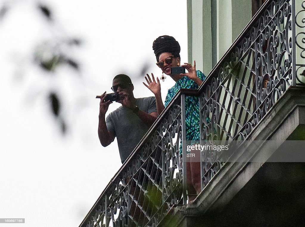 US singer Beyonce is seen in a balcony of the Saratoga Hotel in Havana next to her husband Jay Z, on April 5, 2013. Pop diva Beyonce and her rapper husband Jay-Z on Thursday created a stir as they toured the streets of Old Havana, with hundreds of Cubans turning out to catch a glimpse of the US power couple. AFP PHOTO/STR