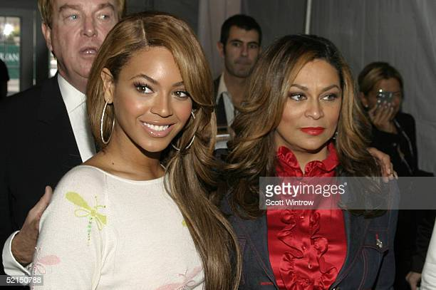Singer Beyonce Knowles and her Mother Tina Knowles pose for photos inside the main tent during Olympus Fashion Week Fall 2005 at Bryant Park February...