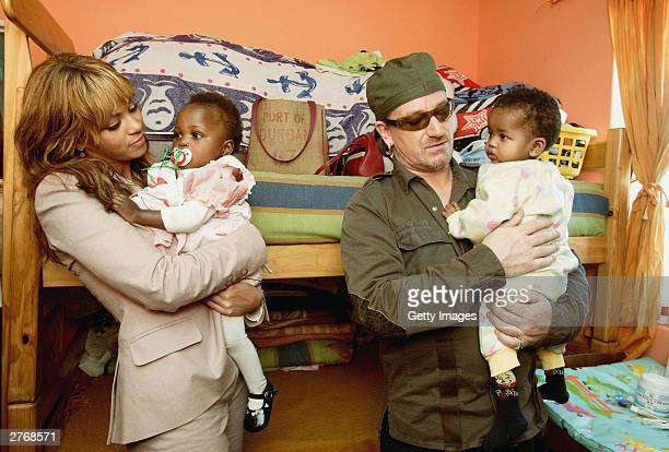 Singer Beyonce Knowles and singer Bono visit the Baphumelele orphanage for children with AIDS whose parents have died of AIDS prior to the '46664...