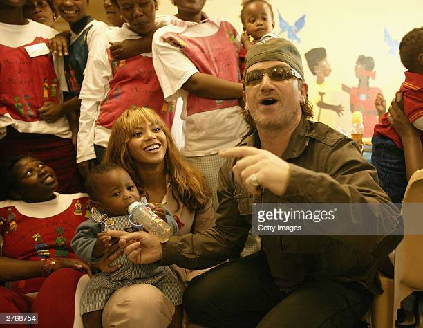 Singer Beyonce Knowles and singer Bono visit the Indawo Yokobelekisa maternity unit prior to the '46664 Give One Minute Of Your Life To AIDS' concert...