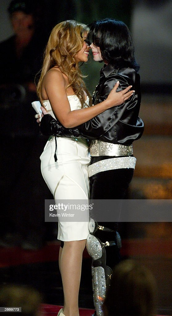Singer Beyonce' Knowles and singer <a gi-track='captionPersonalityLinkClicked' href=/galleries/search?phrase=Michael+Jackson&family=editorial&specificpeople=70011 ng-click='$event.stopPropagation()'>Michael Jackson</a>, winner of the 2003 Humanitarian Award, hug onstage at The 2003 Radio Music Awards at the Aladdin Casino Resort October 27, 2003 in Las Vegas, Neveda. For more information on Jackson's humanitarian efforts, go to musicforgiving.org.