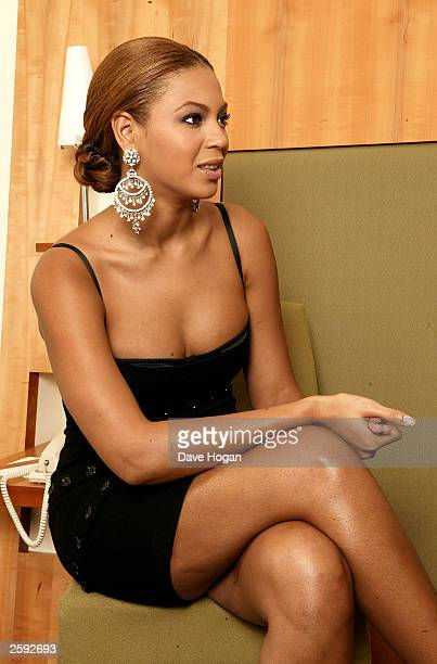 Singer Beyonce Knowles attends a photo session at the Metropolitan Hotel on October 14 2003 in London