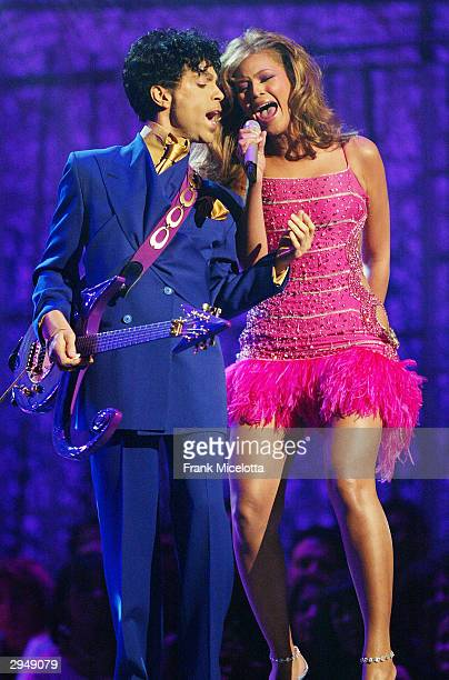 Singer Beyonce Knowles performs Purple Rain with musician Prince at the 46th Annual Grammy Awards held at the Staples Center on February 8 2004 in...