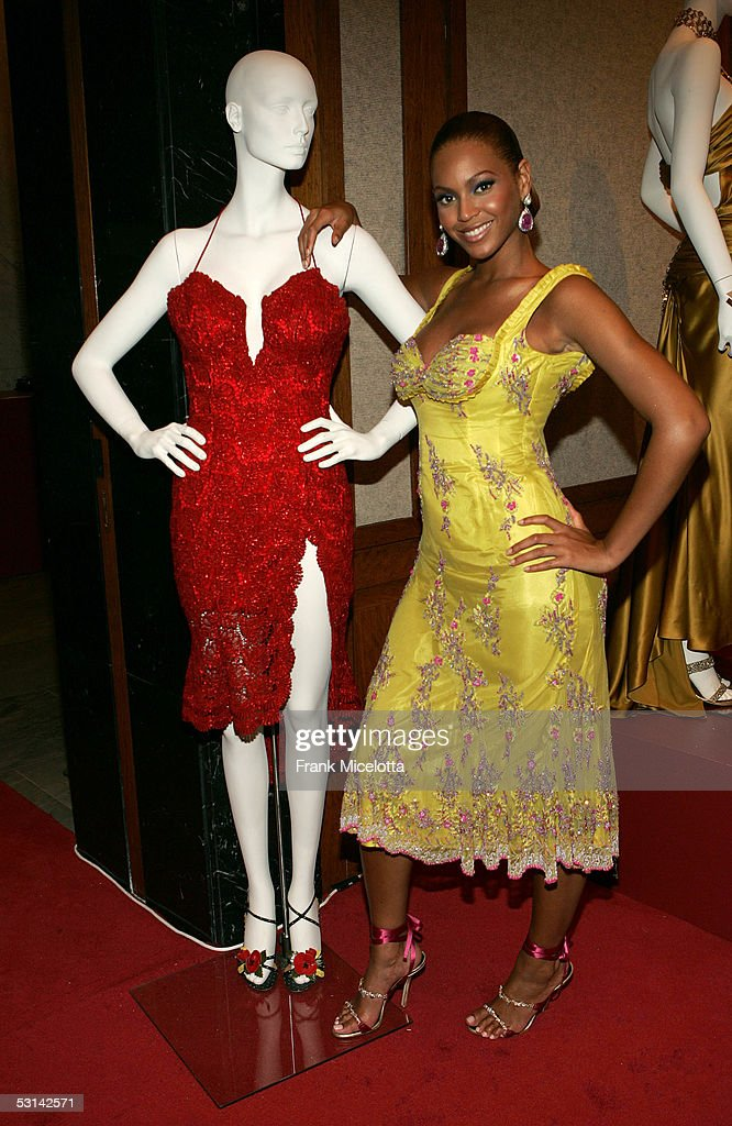 Singer Beyonce Knowles poses for a photo with a manikin adorned with a dress designed by Tina Knowles and worn by Beyonce during her role in MTV's...