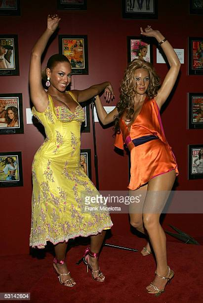 Singer Beyonce Knowles poses for a photo with her waxwork figure at the 'Beyonce Beyond the Red Carpet auction presented by Beyonce and her mother...