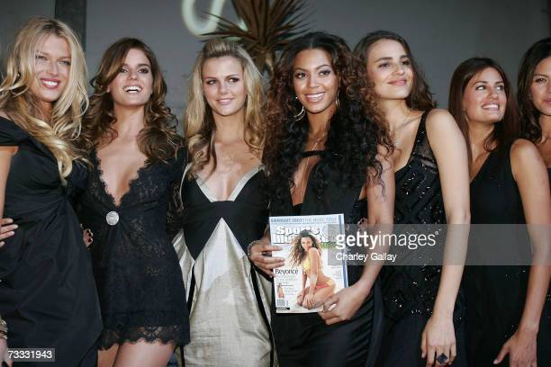 Singer Beyonce Knowles poses with fellow Sports Illustrated Swimsuit Issue models at a reception celebrating the 2007 Sports Illustrated Swimsuit...