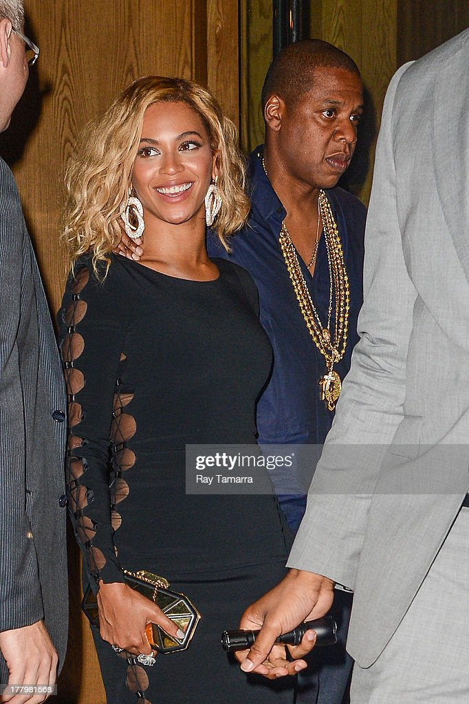Singer Beyonce Knowles-Carter (L) and rapper Jay Z leave the Dream Downtown hotel on August 25, 2013 in New York City.