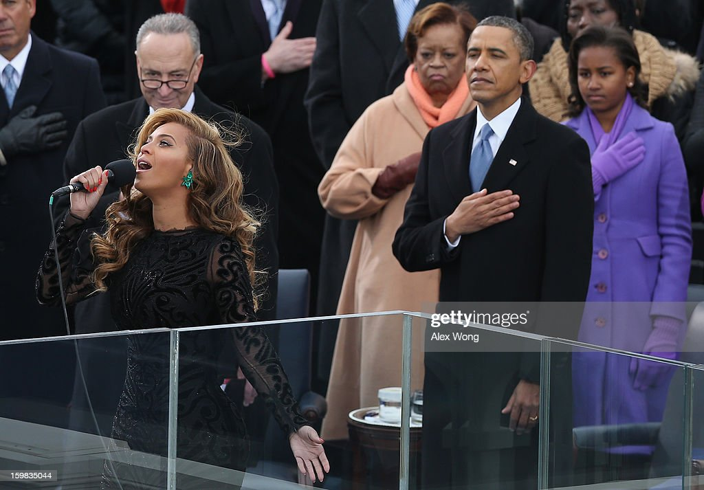 Singer Beyonce performs the National Anthem as US President Barack Obama looks on during the public ceremonial inauguration on the West Front of the...