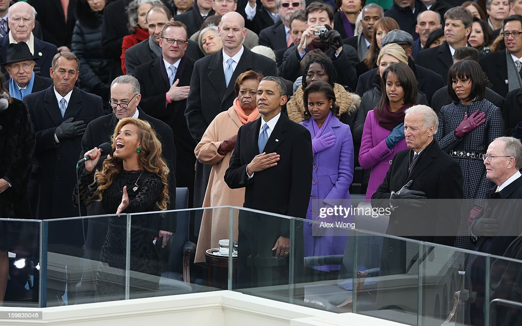 Singer Beyonce performs the National Anthem as U.S. President Barack Obama looks on during the public ceremonial inauguration on the West Front of the U.S. Capitol January 21, 2013 in Washington, DC. Barack Obama was re-elected for a second term as President of the United States.
