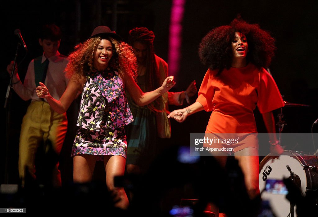 Singer Beyonce (L) performs with her sister Solange Knowles onstage during day 2 of the 2014 Coachella Valley Music & Arts Festival at the Empire Polo Club on April 12, 2014 in Indio, California.
