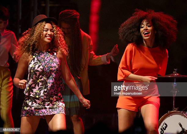 Singer Beyonce performs with her sister Solange Knowles onstage during day 2 of the 2014 Coachella Valley Music Arts Festival at the Empire Polo Club...