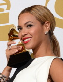 Singer Beyonce poses in the press room at the Staples Center during the 55th Grammy Awards in Los Angeles California February 10 2013 AFP PHOTO Robyn...