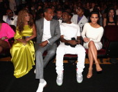 Singer Beyonce rappers JayZ and Kanye West and television personality Kim Kardashian attend the 2012 BET Awards at The Shrine Auditorium on July 1...