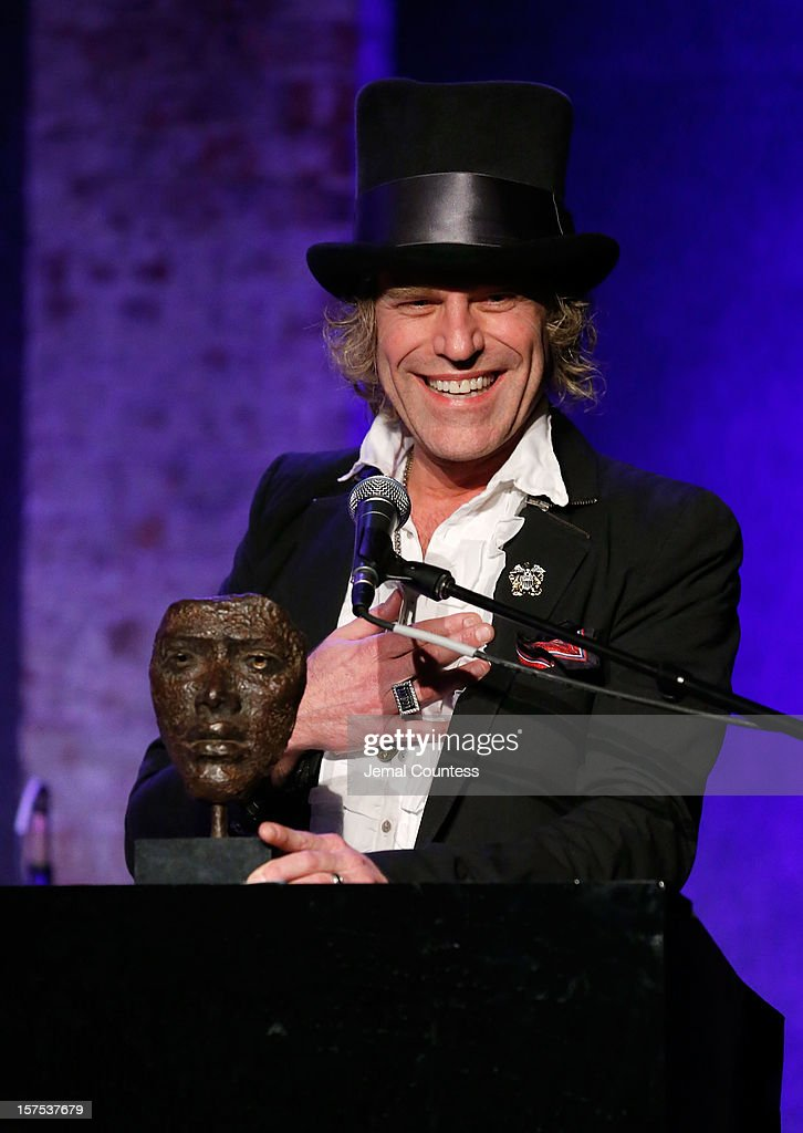 Singer Big Kenny receives a humanitarian honor during the 4th Annual African Children's Choir Fundraising Gala at City Winery on December 3, 2012 in New York City.