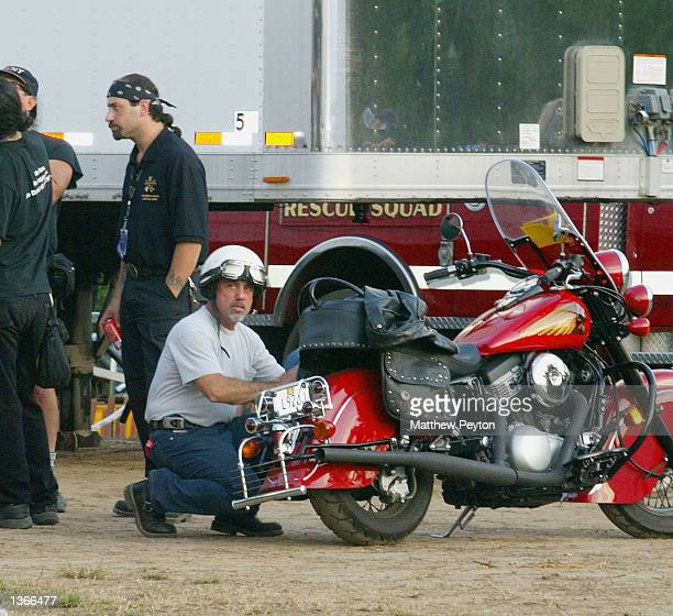 Singer Billy Joel prepares for a sunset ride on his Indian motorcycle at the 'All For The Sea' 10th anniversary concert at Southampton College...