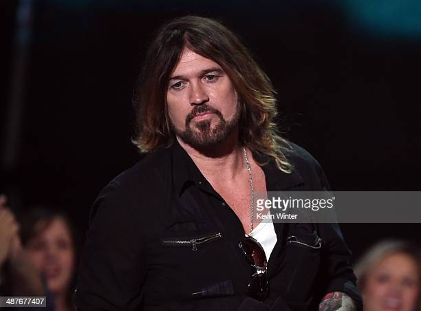 Singer Billy Ray Cyrus accepts the Best Lyrics award for 'Wrecking Ball' on behalf of singer Miley Cyrus onstage during the 2014 iHeartRadio Music...