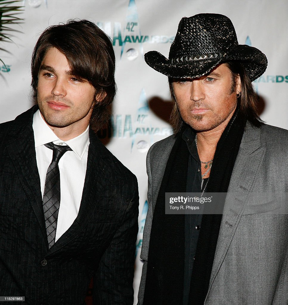Singer Billy Ray Cyrus (R) and model Justin Gaston attend the 42nd Annual CMA Awards at the Sommet Center on November 12, 2008 in Nashville, Tennessee.