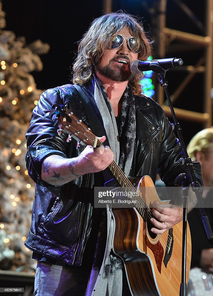 Singer <a gi-track='captionPersonalityLinkClicked' href=/galleries/search?phrase=Billy+Ray+Cyrus&family=editorial&specificpeople=213601 ng-click='$event.stopPropagation()'>Billy Ray Cyrus</a> performs at the 82nd Annual Hollywood Christmas Parade on December 1, 2013 in Hollywood, California.