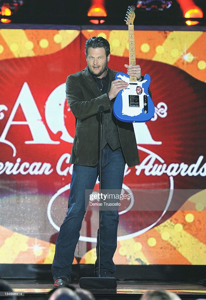 Singer <a gi-track='captionPersonalityLinkClicked' href=/galleries/search?phrase=Blake+Shelton&family=editorial&specificpeople=2352026 ng-click='$event.stopPropagation()'>Blake Shelton</a> accepts the Music Video of the Year Award onstage during the 2011 American Country Awards at MGM Grand Garden Arena on December 5, 2011 in Las Vegas, Nevada.