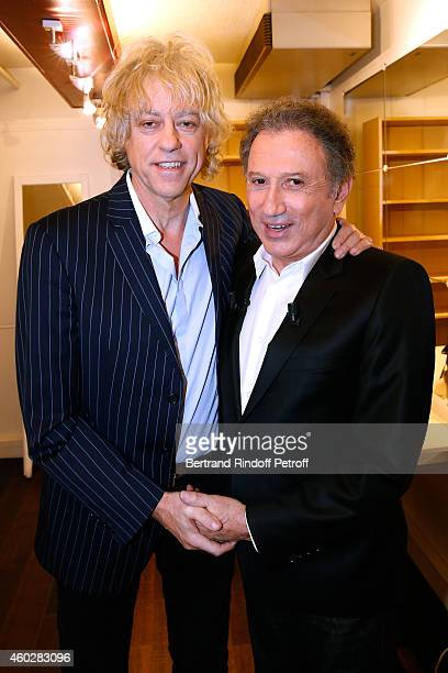 Singer Bob Geldof presents the album 'Band Aid' aganist Ebola virus and presenter of the show Michel Drucker attend the 'Vivement Dimanche' French TV...