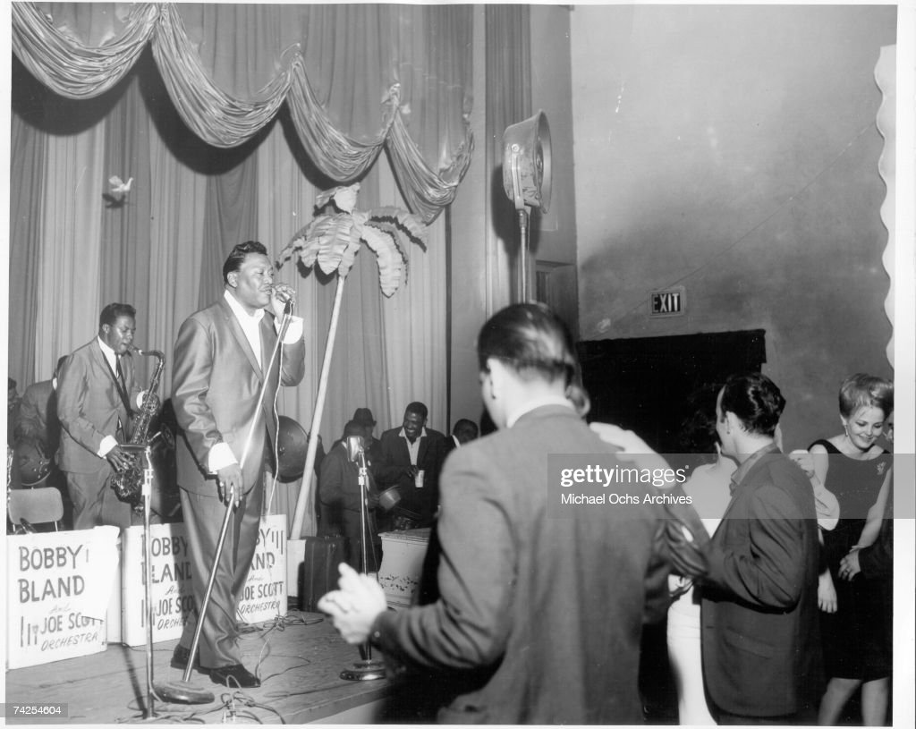 Singer Bobby 'Blue' Bland performs onstage with the Joe Scott Orchestra as people dance in the audience in Houston Texas