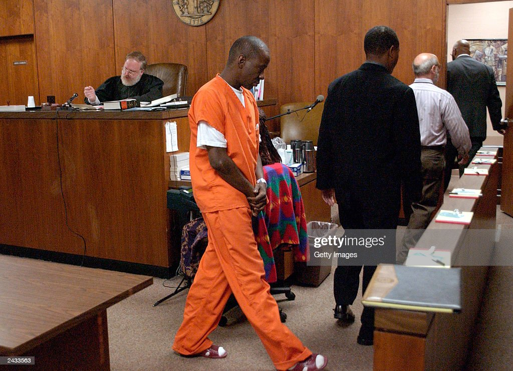 Singer Bobby Brown leaves the courtroom of Judge Wayne Purdom (L), during his appearance before the State Court of DeKalb County on August 27, 2003 in Decatur, Georgia. Brown was arrested last week for probation violation and sentenced to a total of 14 days in the DeKalb County jail. He was also ordered to undergo another drug assessment.