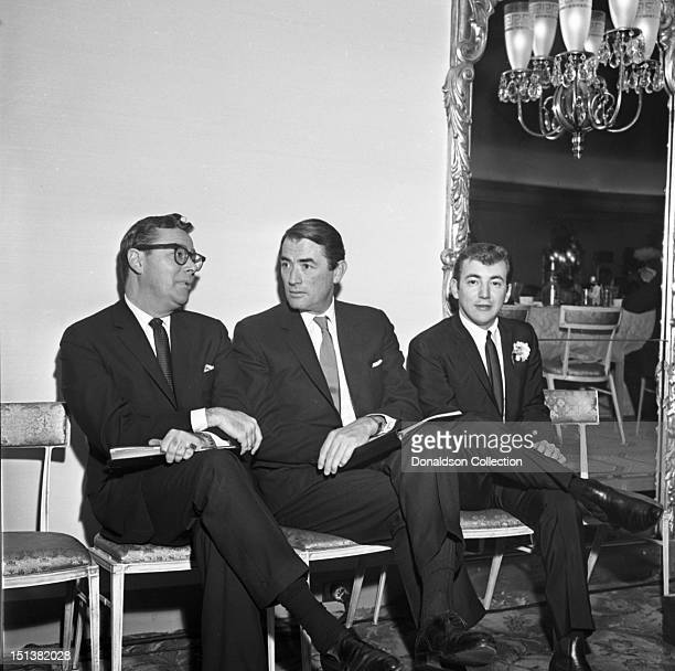 Singer Bobby Darin and actor Gregory Peck with another man at a dinner for the Motion Picture Pioneers Association at the Playboy Club on November 19...