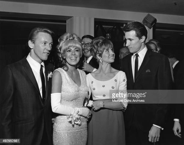 Singer Bobby Hatfield his wife Joy Hatfield and Bill Medley and his wife Karen Klaas of the rock and roll group 'The Righteous Brothers' attend an...