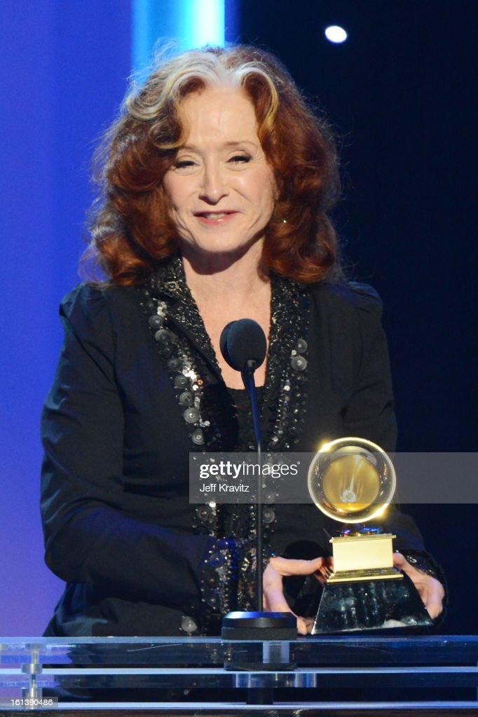 Singer Bonnie Raitt accepts an award onstage during the 55th Annual GRAMMY Awards at Nokia Theatre L.A. Live on February 10, 2013 in Los Angeles, California.
